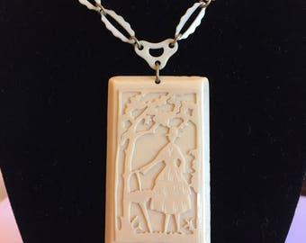 Large celluloid vintage 1930s art deco lady pendant and chain