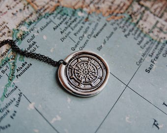 adventurer. a silver wax seal compass travel necklace