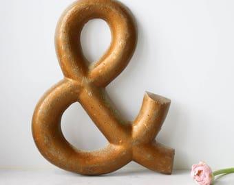 Bronze Cement Ampersand Shop Sign
