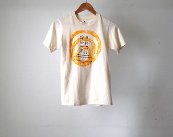 vintage 1979 Academy Of CHINESE WUSHU martial arts faded cream women's t-shirt