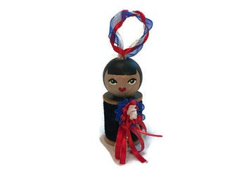 Homecoming Doll: Vintage Wood Spool with a red, white, and blue mum.