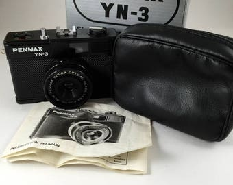 Pemex YN-3 35mm plastic toy camera with box, case and instructions