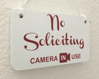 No soliciting sign Camera in Use with Ribbon - Handmade in USA -Solid wood Cute Red/White security  signage for home or business.