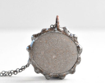 Round flat beach stone pendant, Stone jewelry, Natural gifts for women and men, Gray soft satin with rustic textured soldered edges