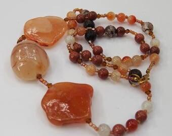 Long asymmetrical carnelian agate statement necklace Rough natural stone nuggets Burnt orange tan honey brown Warm color Artisan ALFAdesigns