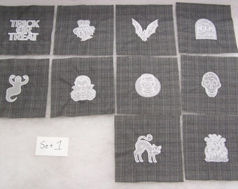 First Set of Halloween Embroidered Squares on Dark Gray Fabric