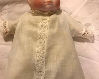 "Antique Bisque Bye-Lo Baby 9"" long original clothes"