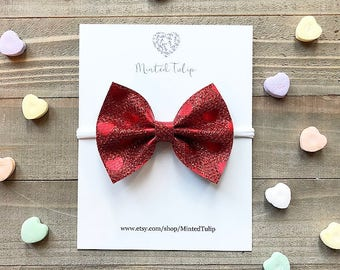 Metallic Red Heart Print Faux Leather Bow on Nylon Headband or Alligator Clip Baby Toddler Kids