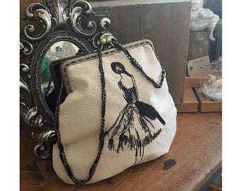 Ballerina embroidered clutch bag