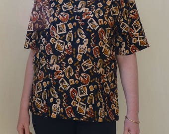 """Black with browns abstract """"tribal"""" inspired print short sleeved top- S/M"""