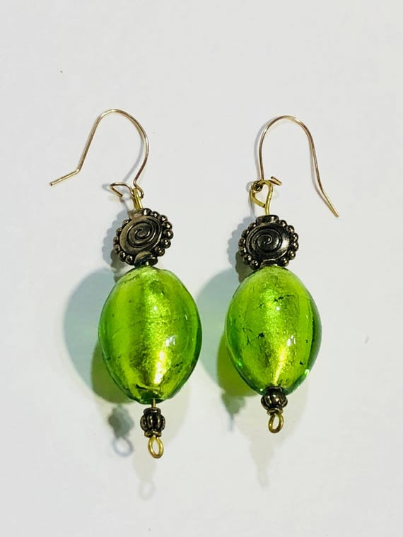 Green oval glass bead earrings with gold plated ear wires and brass spiral beads