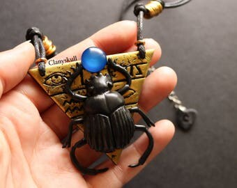 Black Egyptian beetle necklace.