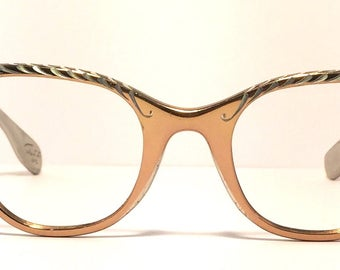 Vintage eyewear. Stunning Tura cat eye! 1950's. Golden bronze Aluminum. Silver etched designs across front. Midcentury perfection! Hip Diva!