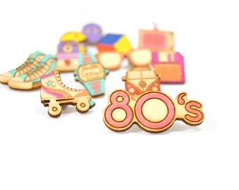 Laser cut wooden pins, hand-painted and inspired in the 1980s
