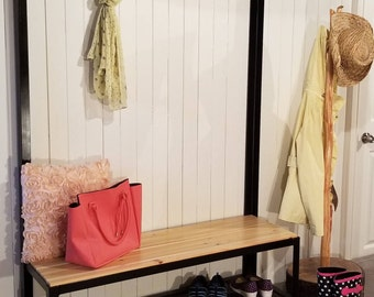 Glamorous entryway seat with hooks and a shelf