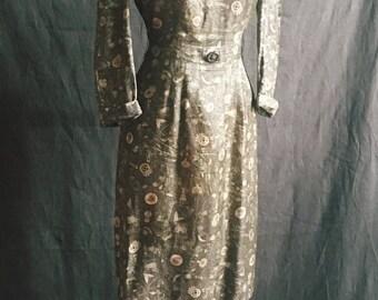 1950s hieroglyphics silk dress in olive green.