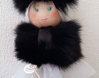 a doll in furs