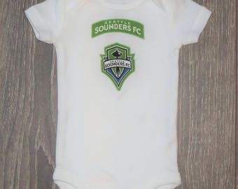 Sounders onsie size NB, gender-neutral or add a bow for a girl!  Ready to mail.