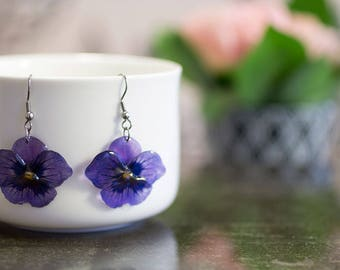 Resin, Purple pansy flower earrings, transparent. Comes in a gift box.