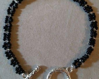 Black beaded bracelet with bow