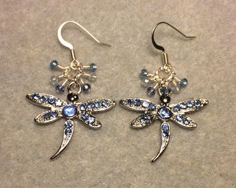Silver and light blue rhinestone dragonfly charm earrings adorned with tiny dangling light blue Chinese crystal beads.