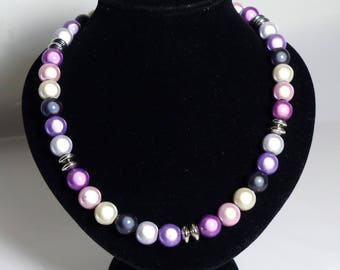 Distinctive and unique Miracle bead/Glow bead necklace with silver plated rondelles in purples