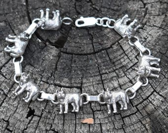 Carol Felley sterling silver petite wolf bracelet, solid dimensional wolf dogs 6.5 inches rare 1991 southwest piece.