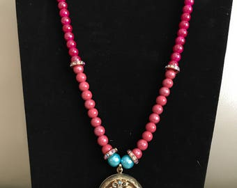 Pink and purple beaded rope necklace with gold locket