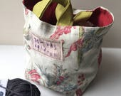 Storage Basket, linen/cotton fabrics upcycled from fabric sample book with red liner