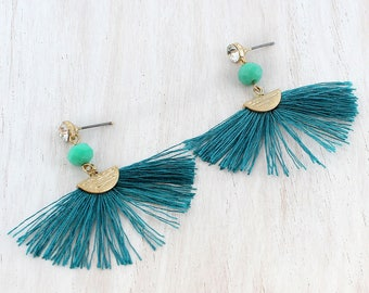 Crystal & Bead Accented Teal Fan Tassel Earrings   These colorful earrings will add the perfect touch to your outfit