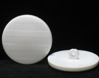 Set of 7 white broken buttons, 27mm in diameter