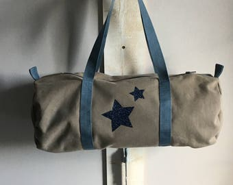 Beige and blue canvas duffel bag