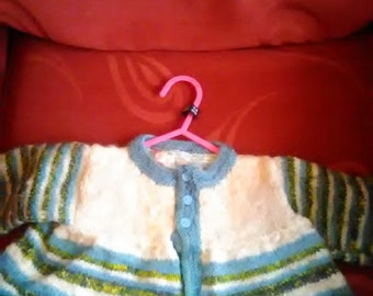Hand knitted cardigan, knitted in home spun wool to fit a baby girl aged 3-6 months old