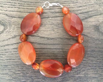 Large Faceted Oval and Faceted 6mm Round Carnelian Bracelet