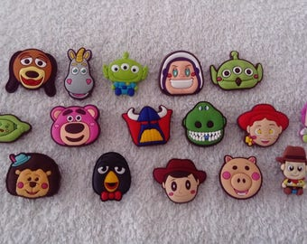 Lot 16 jibbitz toy story (badges for fangs)