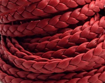flat red leather braided by 20 cm.
