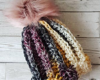 Chunky knitted hat with fur pom pom