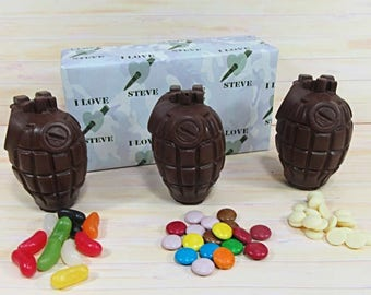 Valentines Chocolate, three milk chocolate grenades with jelly beans, white buttons and 'smarties'