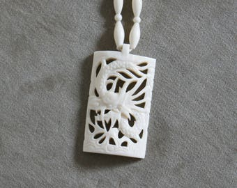 Vintage Chinese oriental carved (ox-) bone dragon necklace with pendant.