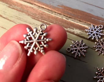 Snowflake charms silver tone Christmas charms DIY lot of 12 Holiday Jewelry making supplies