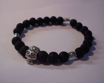Man, lava stone and skull bracelet
