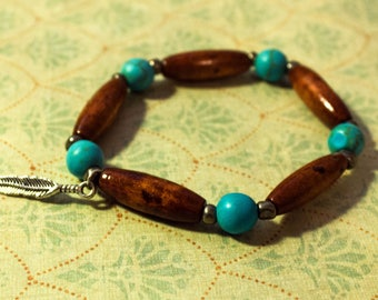 Turquoise and Wooden Elastic Bracelet with Feather Charm