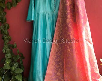 Skyblue long length anarkali paired with coral pink banaras dupatta.