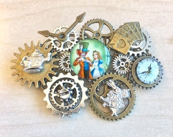 Alice in wonderland steampunk brooch with clockwork,  cogs, gears and charms