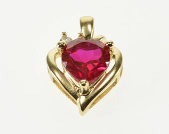 10k Heart Cut Ruby* Diamond Accented Pendant Gold