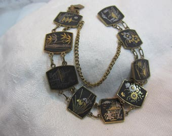 Vintage CD Caribe Asian Damascene Bracelet Featuring Nine Different Tiles with Inlaid Brass and Steel Scenes