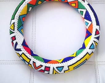 Small Ndebele hoop (Isigolwani) with colourful interior.