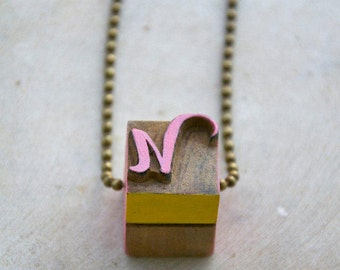 Vintage wooden typographic necklace. Antique bronze chain. Letter N pink yellow wood