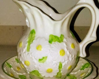 Vintage ceramic pitchers with saucers , cream pitchers