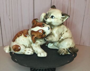 Puppy and kitten play statue by Enesco